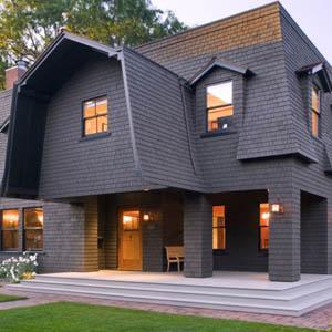 Преимущества и фото фасадов частных домов с мансардным этажом