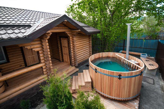 деревянная баня с жилыми комнатами